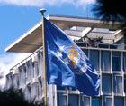 WHOGeneva-HQ-with-flag-140p