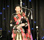 Traditional bagpiper 800p