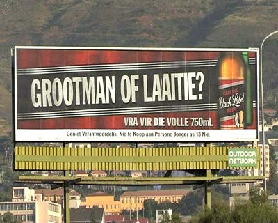 """The picture above is one example of South African alcohol advertising. """"Are you a big man or a small boy"""", asks the huge billboard from Carlings, promoting big 750 ml bottles of their beer Black Label."""