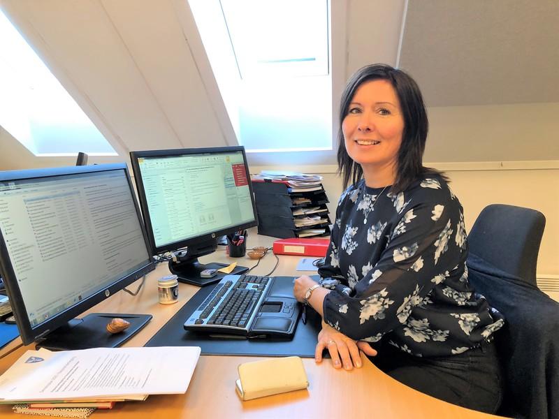 Bilde av Uberg ved kontorpult