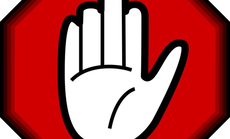 Stoppskilt med ei hand